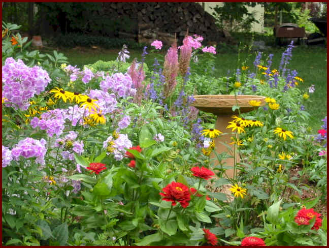 Here's a flower garden that uses a birdhouse.